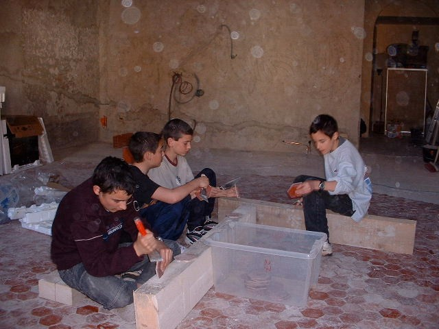 Local kids cleaning gifted tiles